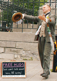 The Hugger Busker offering Free Hugs